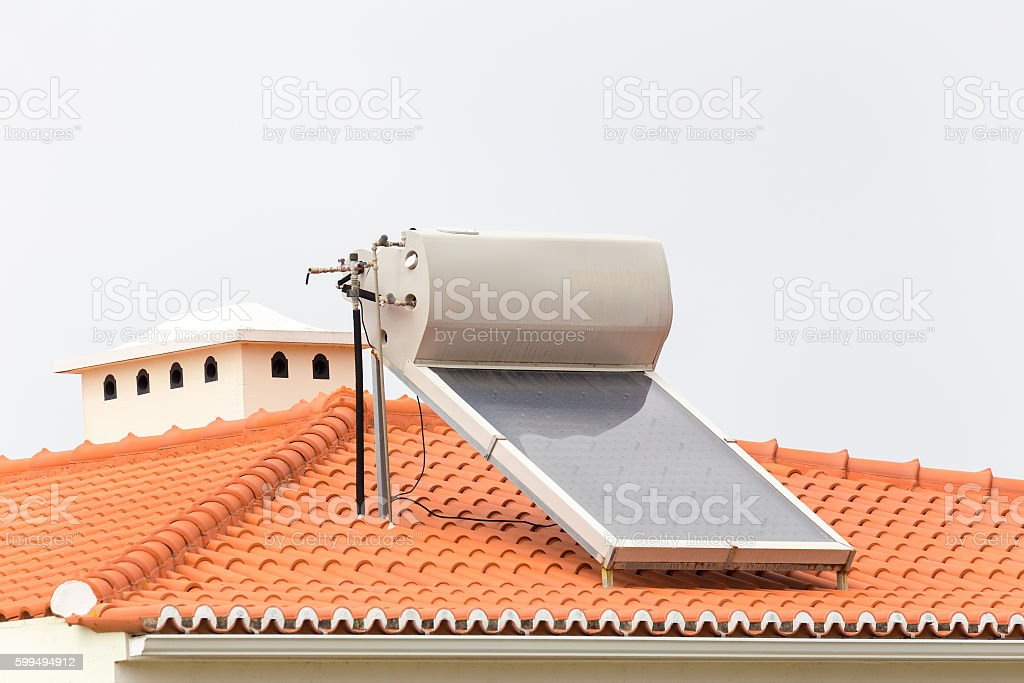 Hot water boiler with solar panel on roof stock photo