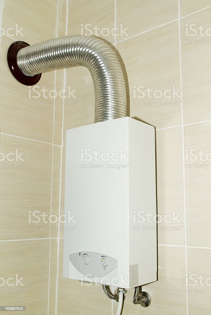Hot water heater in bathroom stock photo