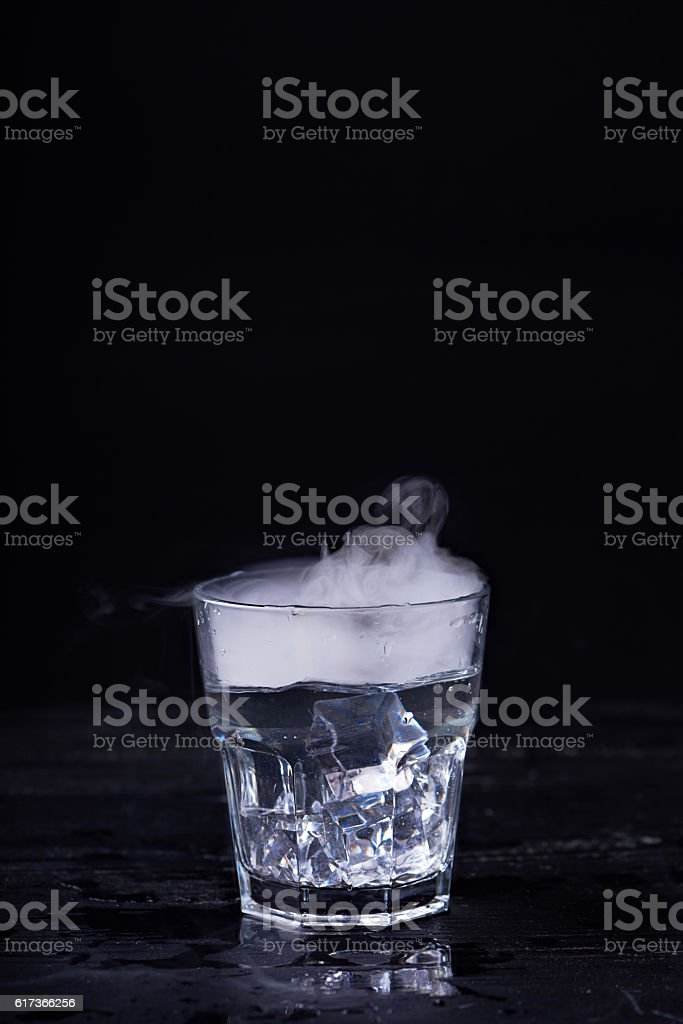Hot water in a glass stock photo