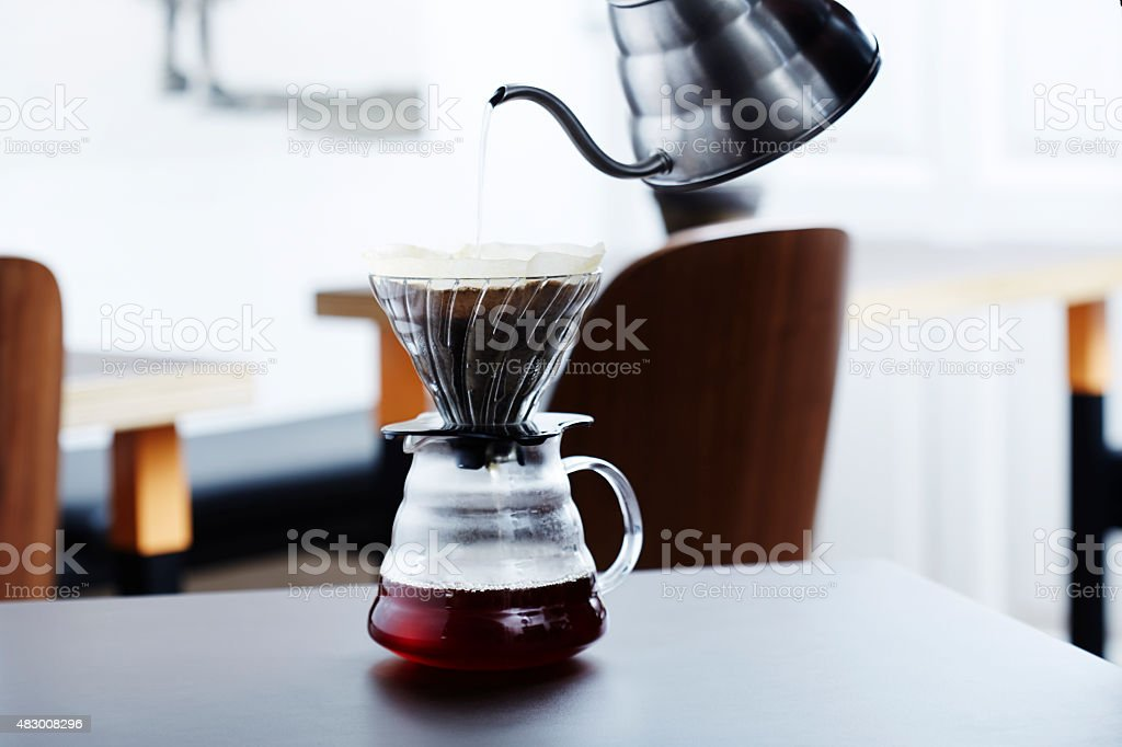 Hot water into coffee maker in morning stock photo