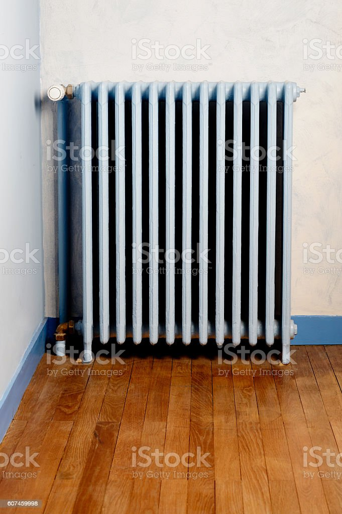 Hot water steam radiator heater in home stock photo
