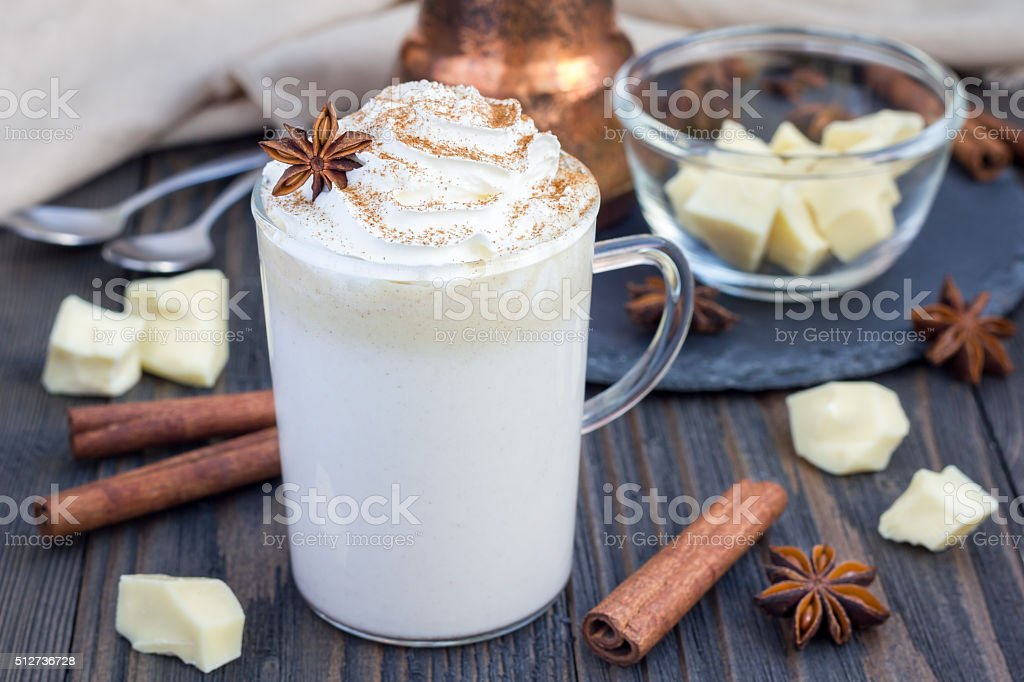 Hot white chocolate, decorated with whipped cream and cinnamon. stock photo
