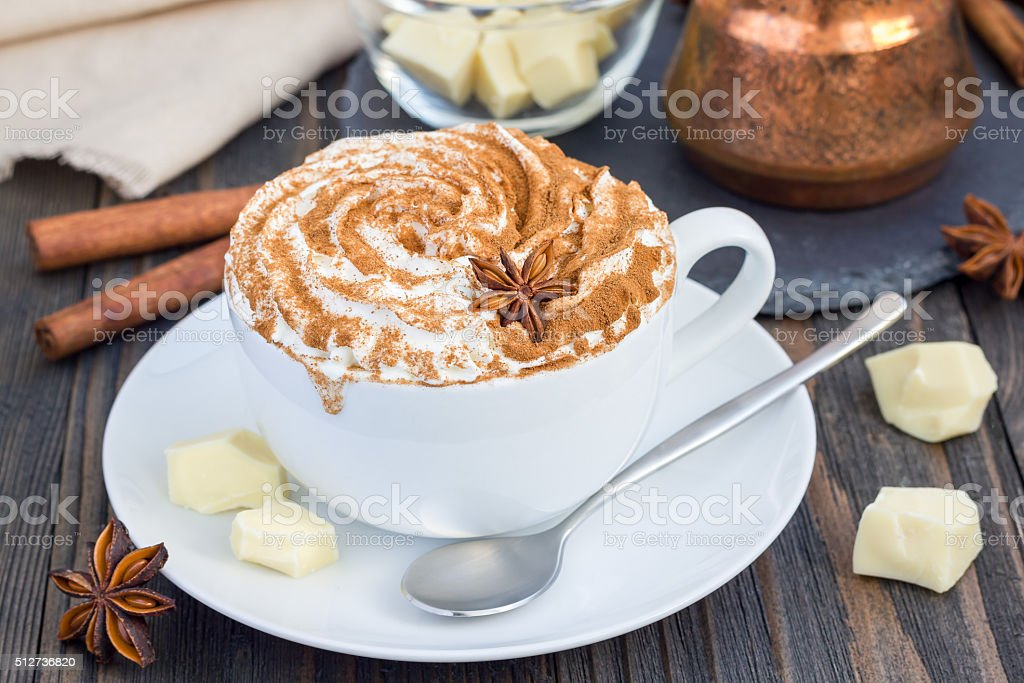 Hot white chocolate, decorated with whipped cream and cinnamon stock photo