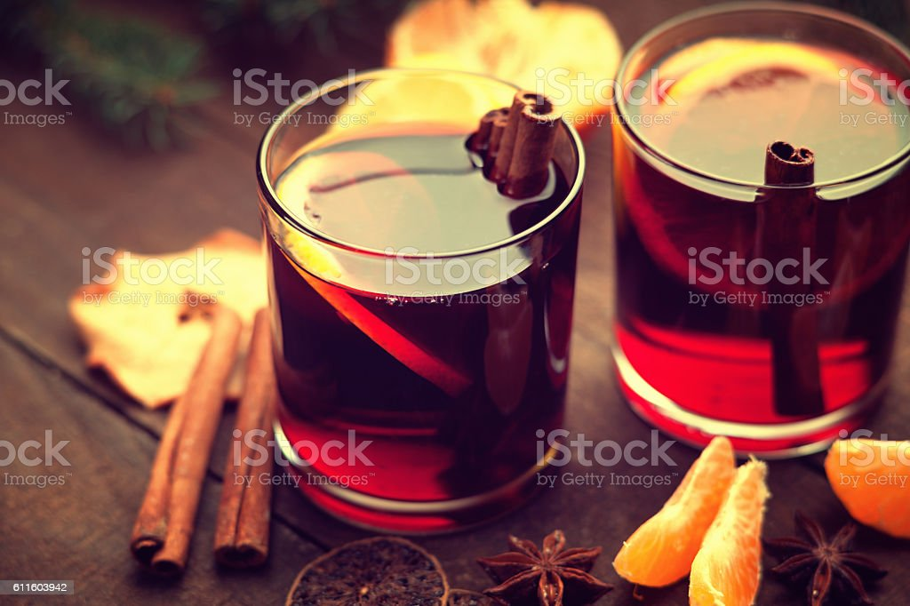 Hot wine, dried apple and slices of mandarin stock photo