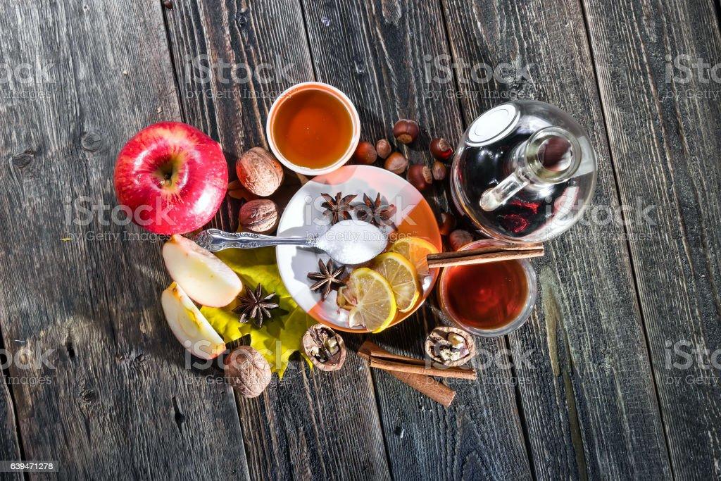 Hot wine, tea, honey and lemon stock photo