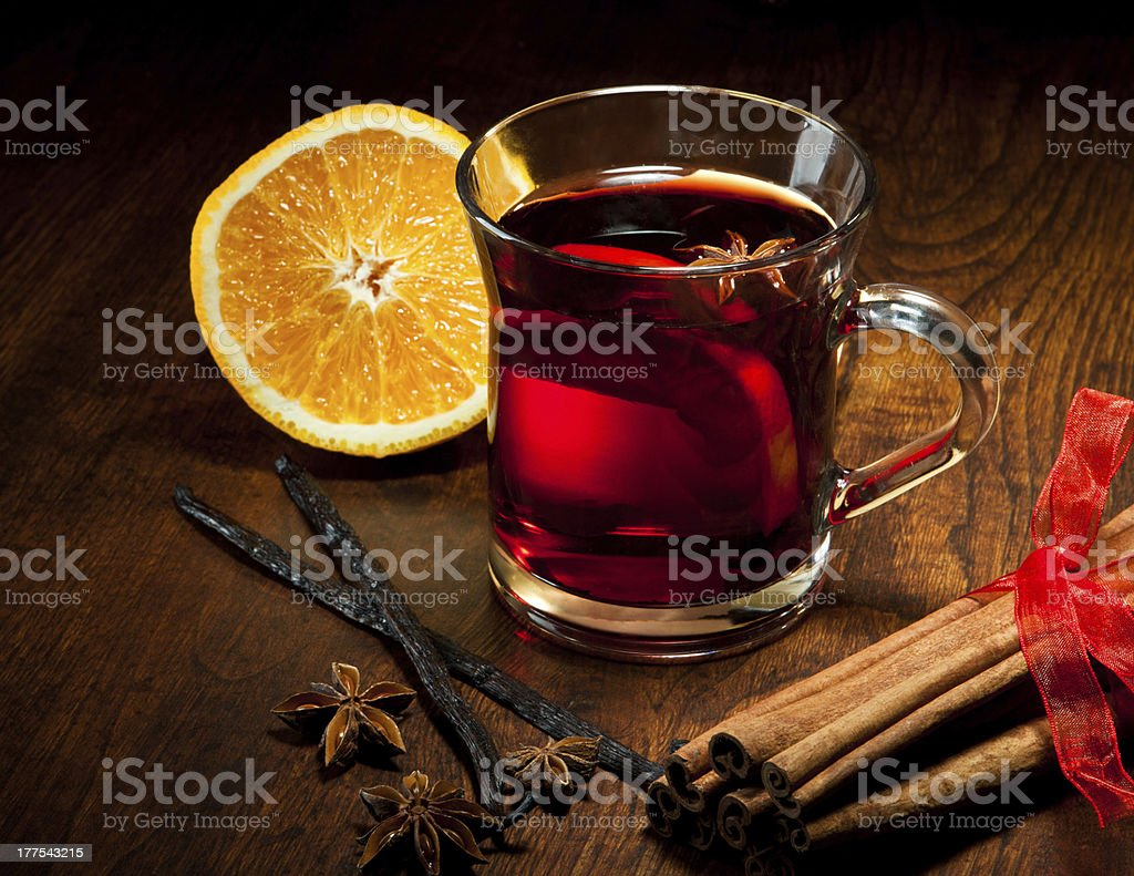 Hot wine with delicious orange and spices stock photo