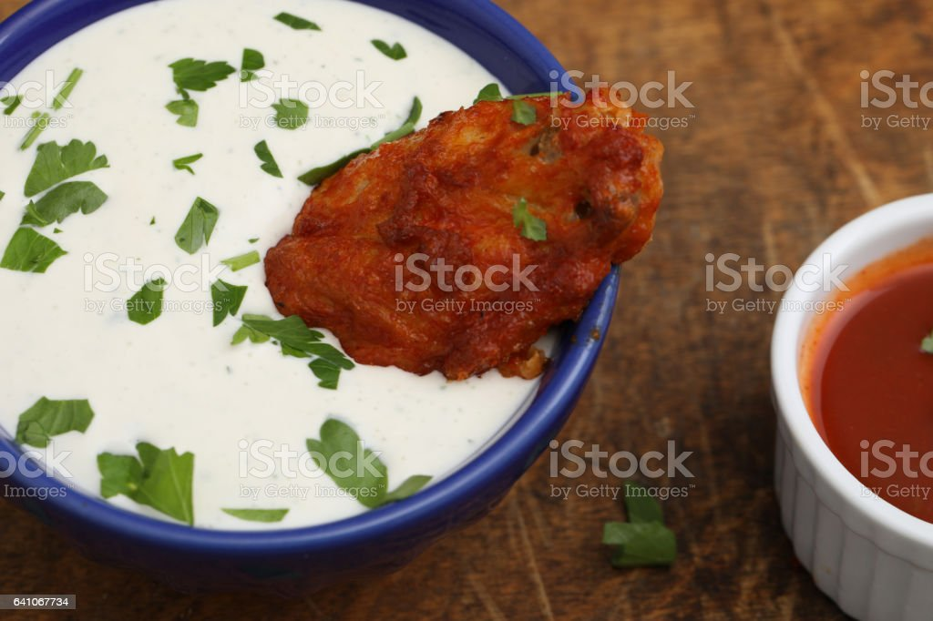 Hot Wing In Dipping Sauce stock photo