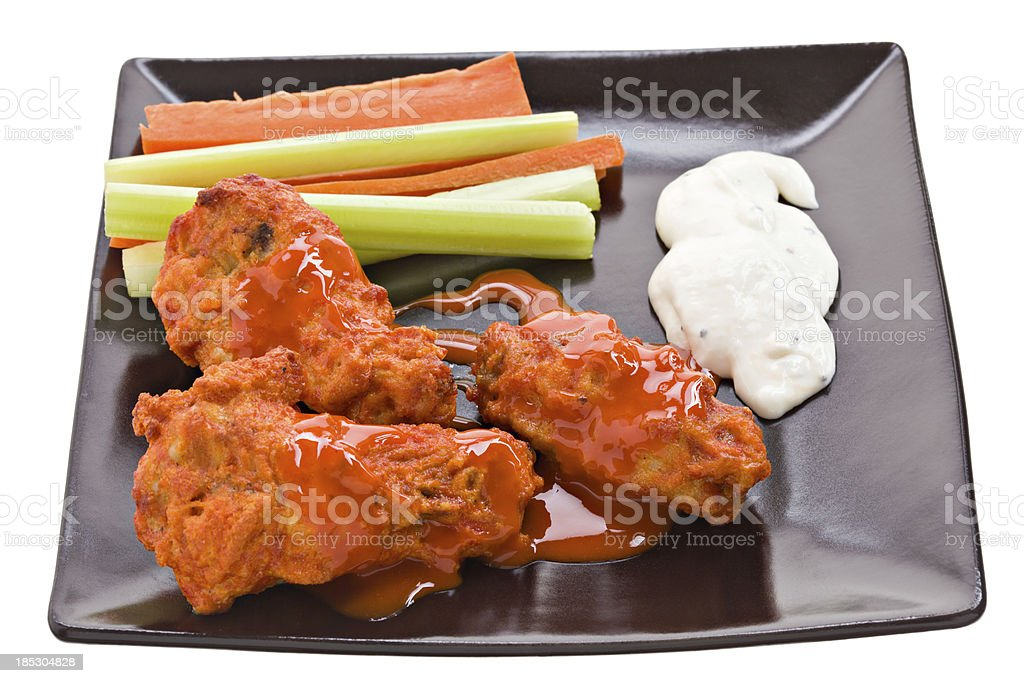 Hot Wings On A Black Plate stock photo