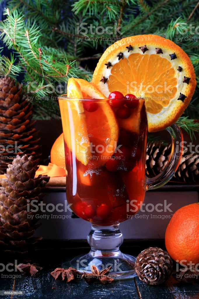 Hot winter drink with cranberry orange and cinnamon stock photo