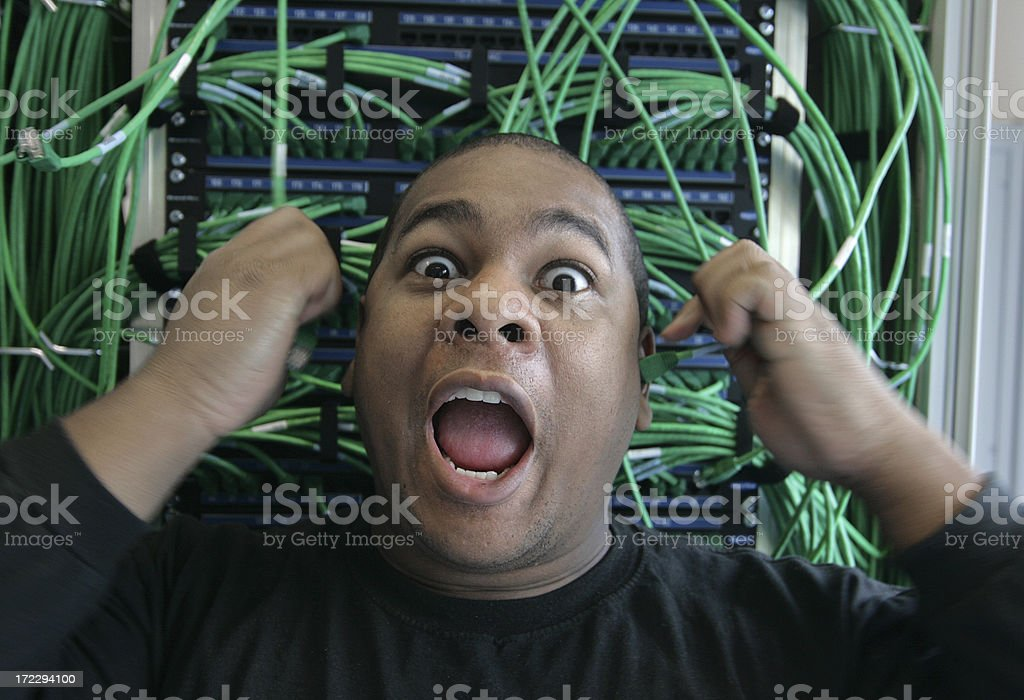 Hot Wired! Afro american IT professional with wires goes crazy royalty-free stock photo