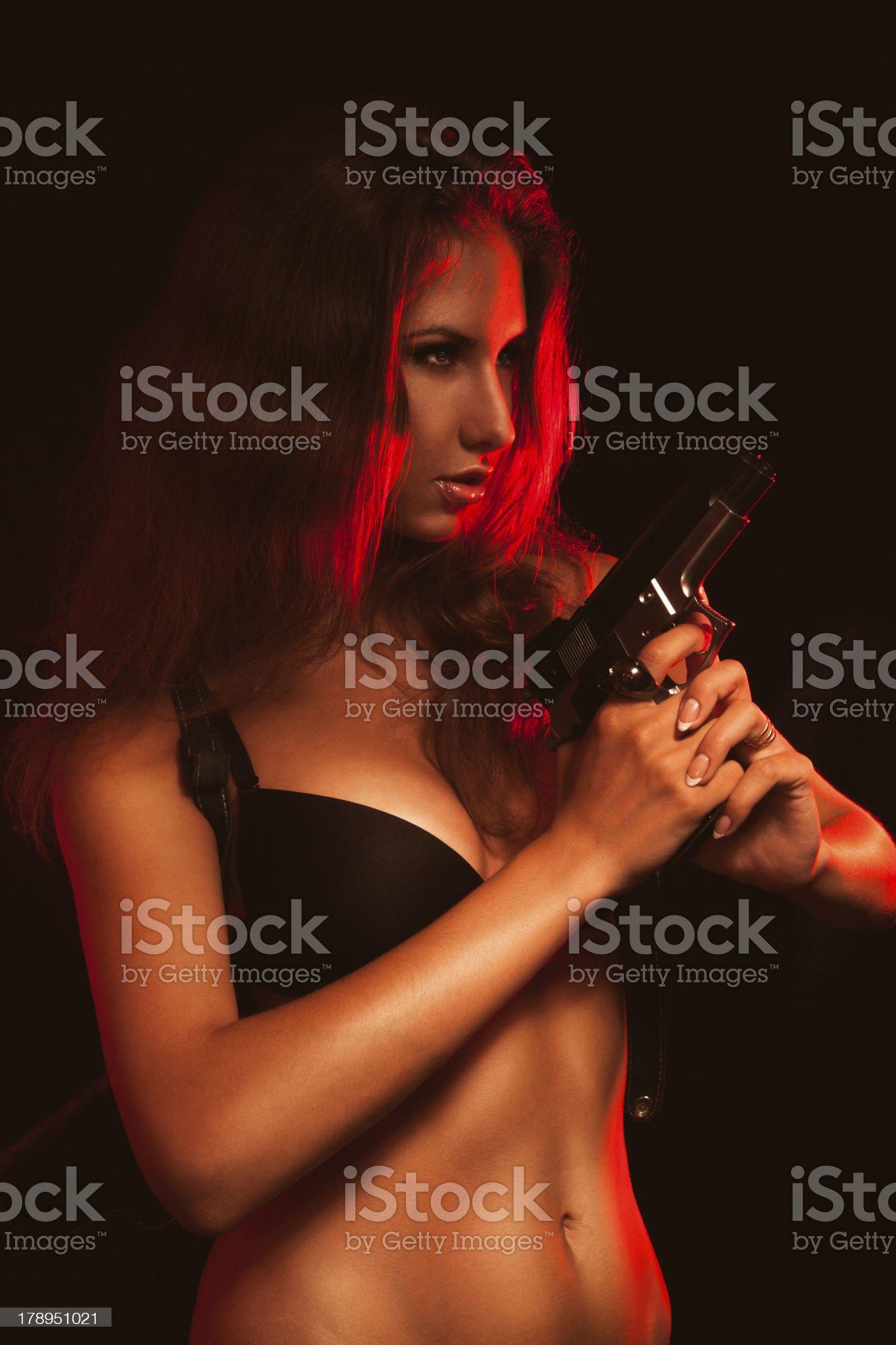 Hot woman in black bra and gun royalty-free stock photo