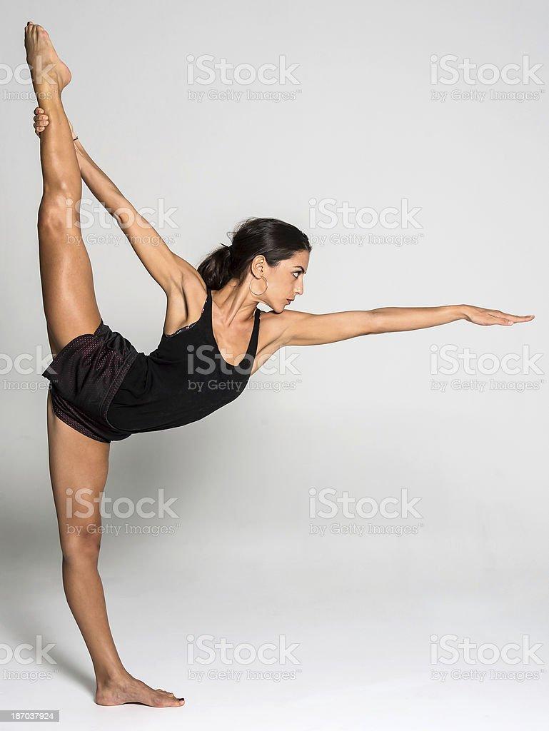 Hot Yoga Pose ( One Legged Upward Facing Bow Pose) stock photo