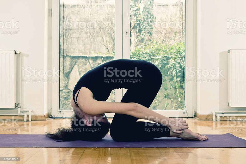 Hot yoga rabbit pose stock photo