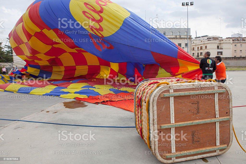 Hot-air balloon basket on the ground stock photo