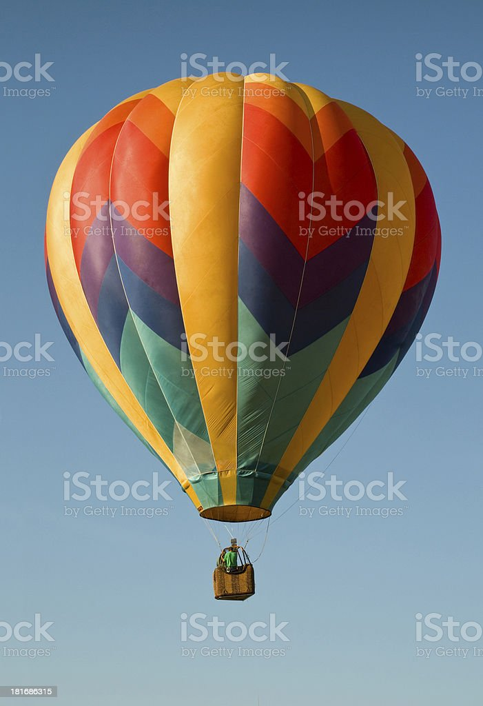 Hot-air balloon floating in a blue sky royalty-free stock photo