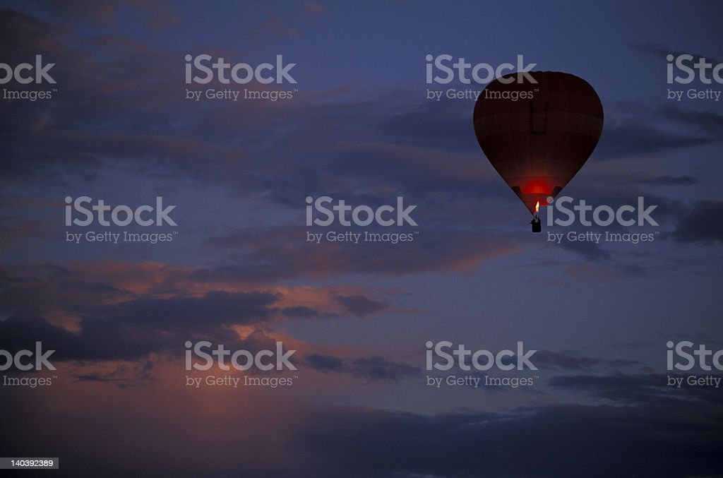 Hot-air balloon in mid air during sunset royalty-free stock photo