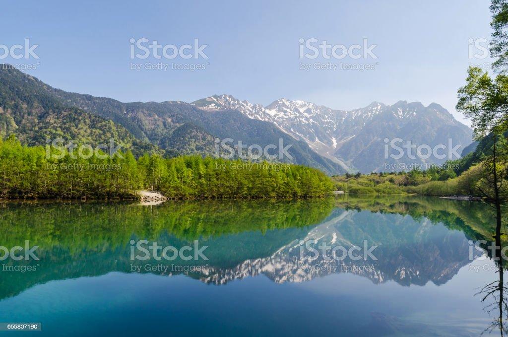 Hotaka mountain range reflect on taisho ike pond in spring at kamikochi national park nagano japan stock photo