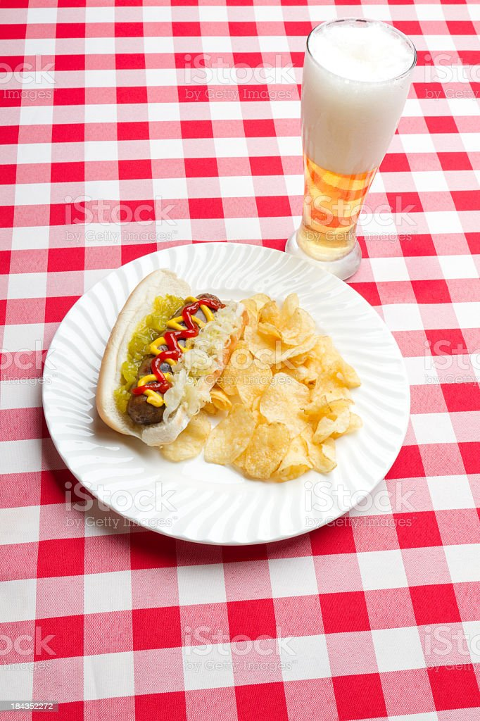 Hotdog with side dishes royalty-free stock photo