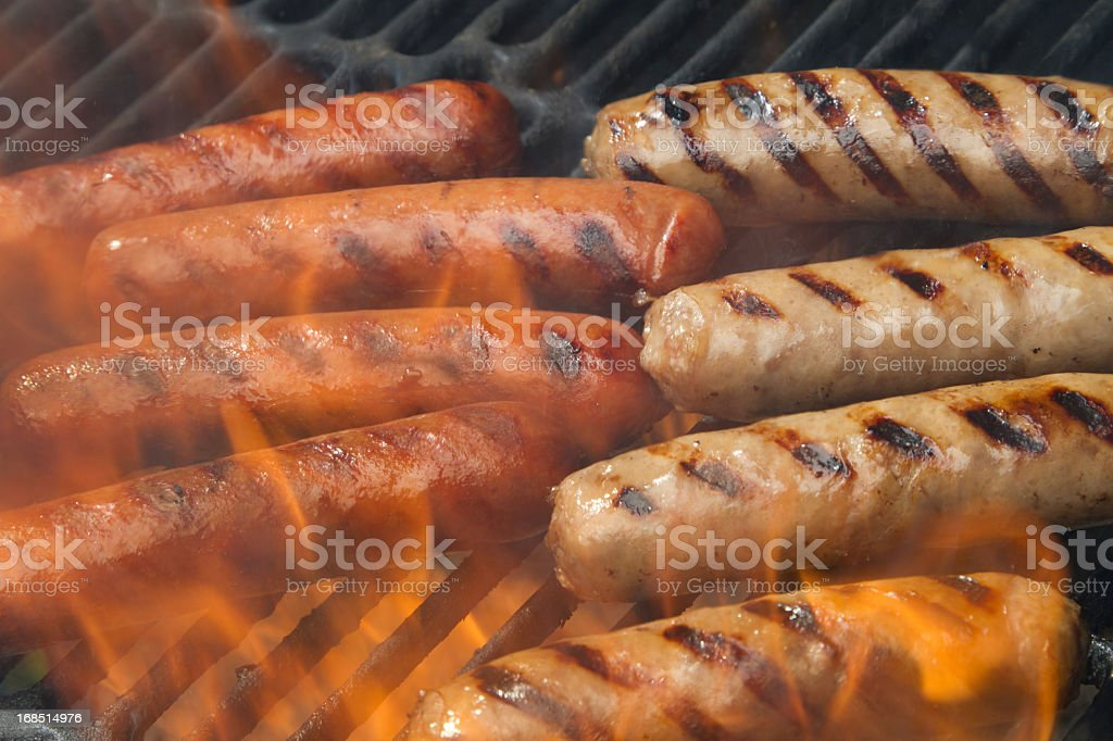 Hotdogs and bratwurst on the grill stock photo