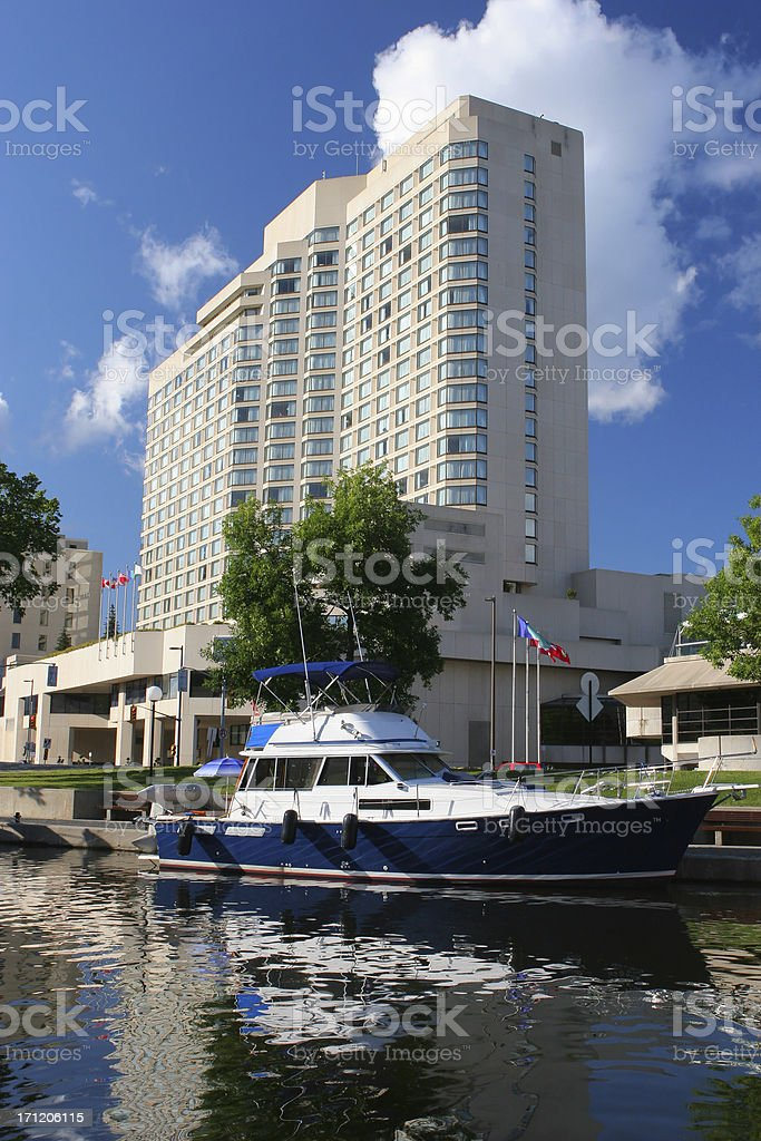 Hotel and boat near the canal Rideau in Ottawa royalty-free stock photo