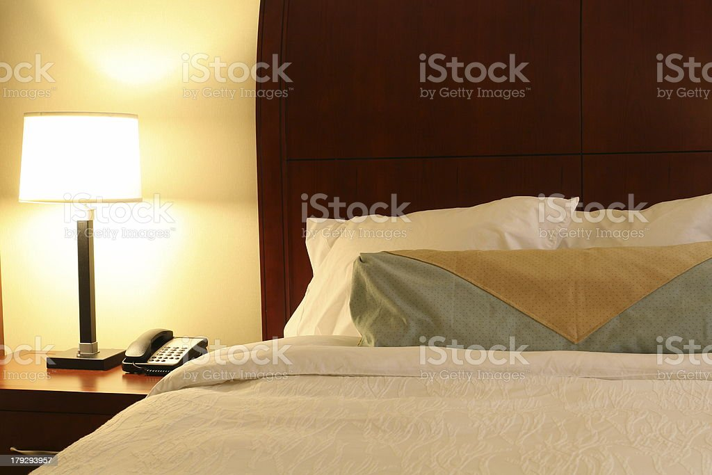 Hotel Bed & Night Table royalty-free stock photo