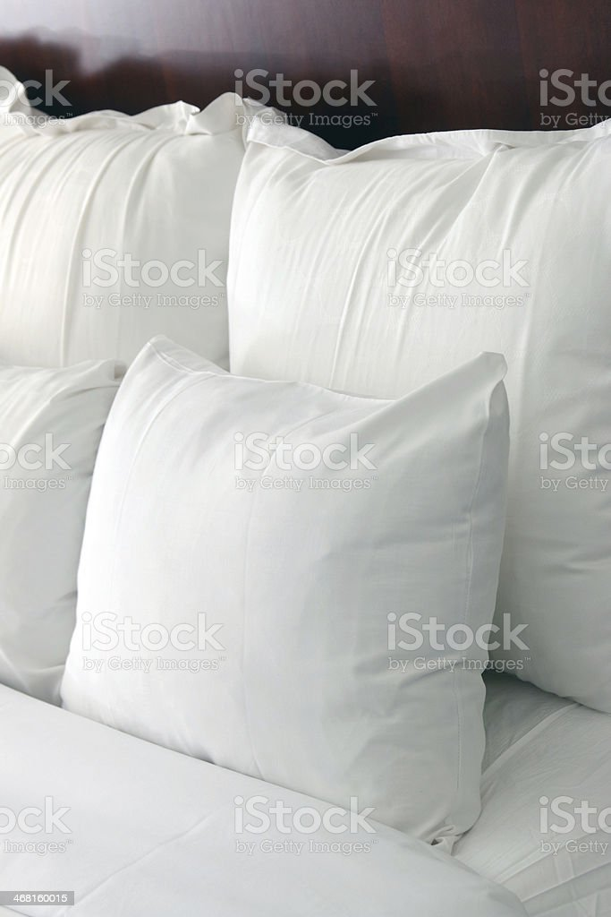 Hotel bed pillows with morning light stock photo
