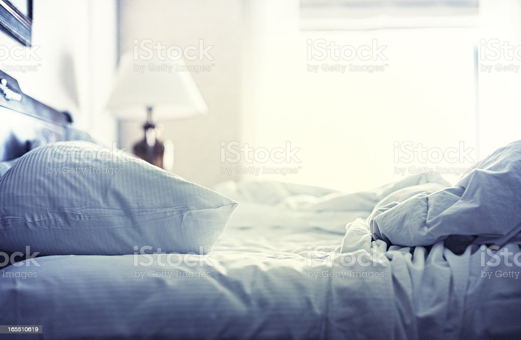 Hotel Bed, White Sheets, Morning After stock photo