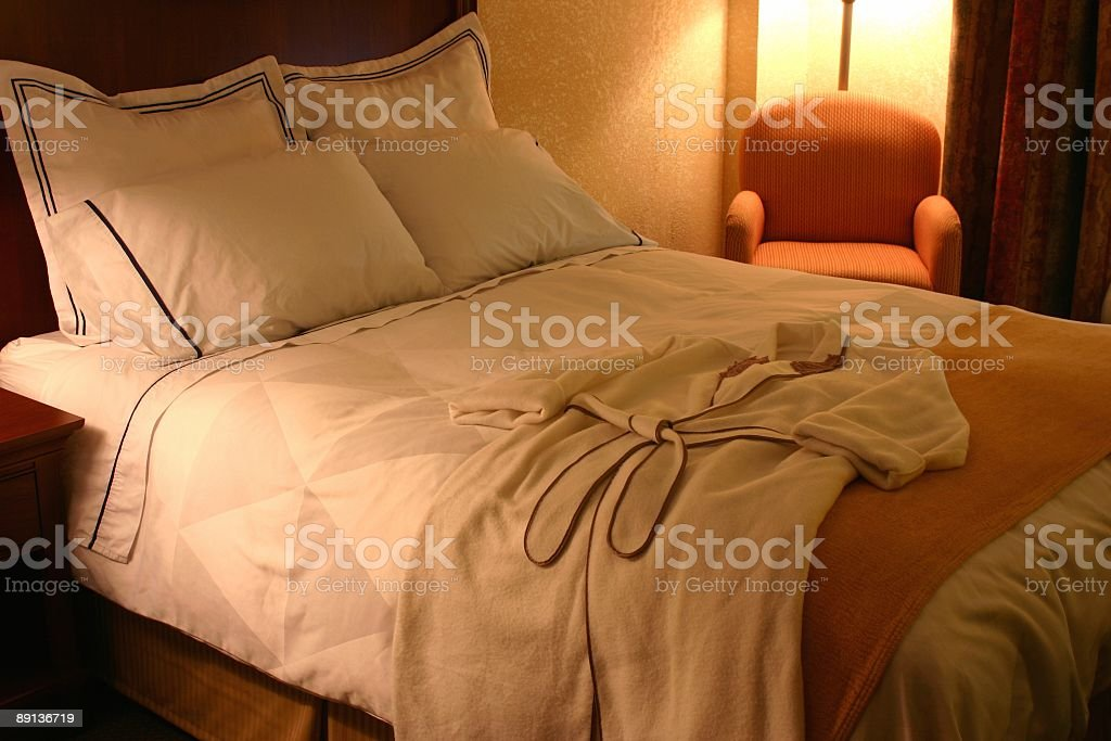 Hotel Bed with Robe royalty-free stock photo