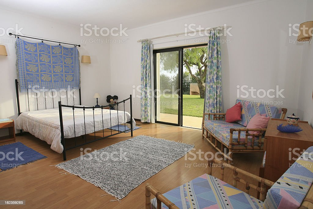Hotel bedroom with outside door to a garden royalty-free stock photo