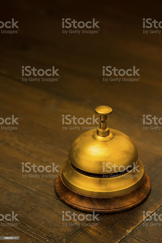 Hotel bell on hall counter royalty-free stock photo