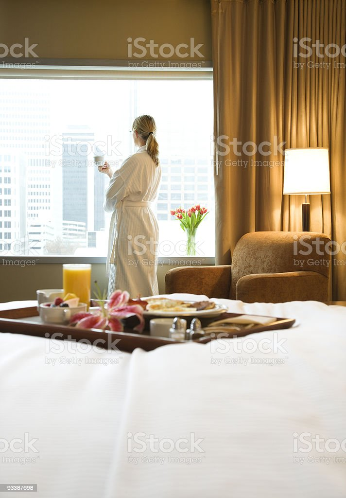 Hotel breakfast with woman in background. stock photo