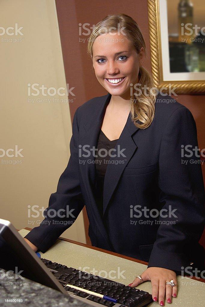 Hotel Desk Smile stock photo