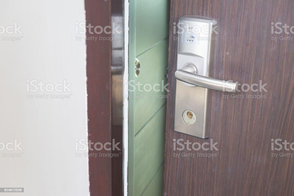 Hotel door with keyless entry card on wood door stock photo