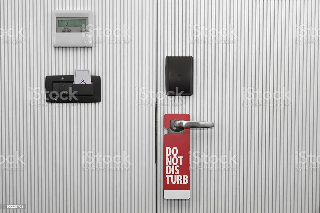 Hotel Door With Sign Do Not Disturb And Safety System stock photo