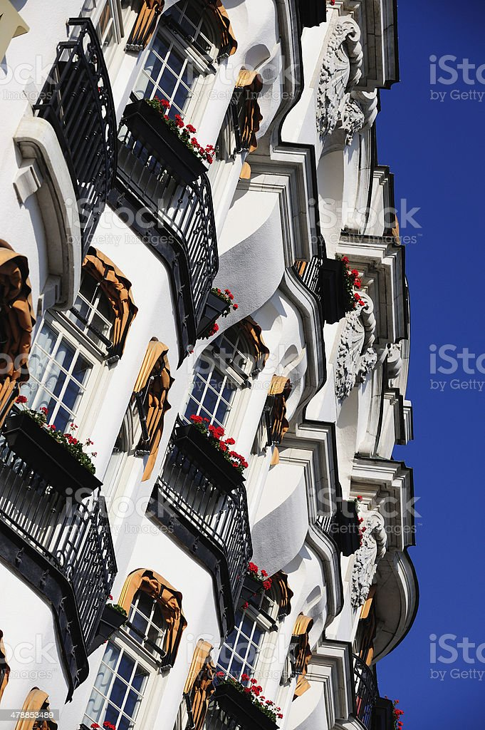 Hotel facade with balconies and flowers royalty-free stock photo
