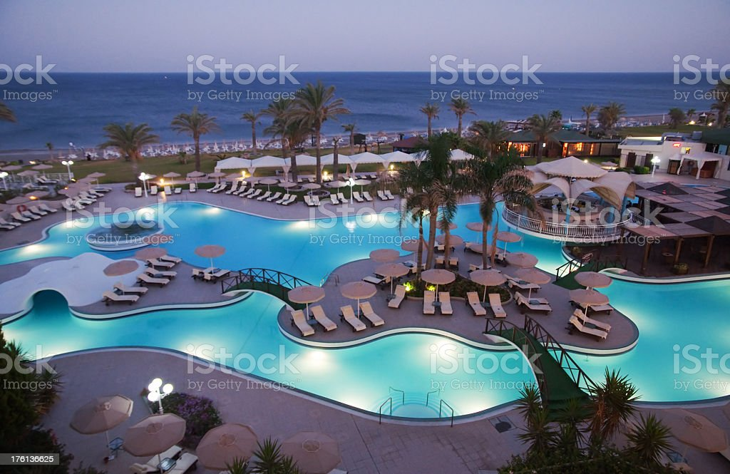 Hotel garden with swimming pool stock photo