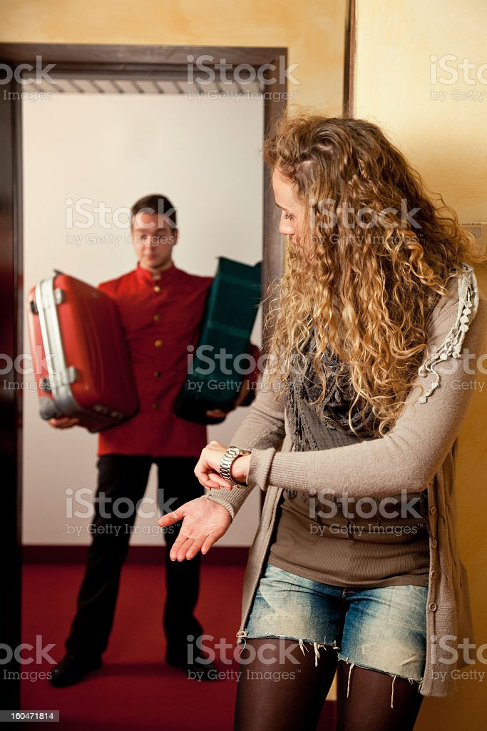 Hotel guest attending the porter with luggages royalty-free stock photo