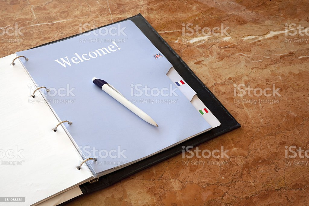 Hotel guestbook on marble surface stock photo