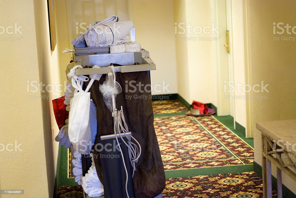 Hotel Housekeeping Cart and Room Service Tray in a Hallway stock photo