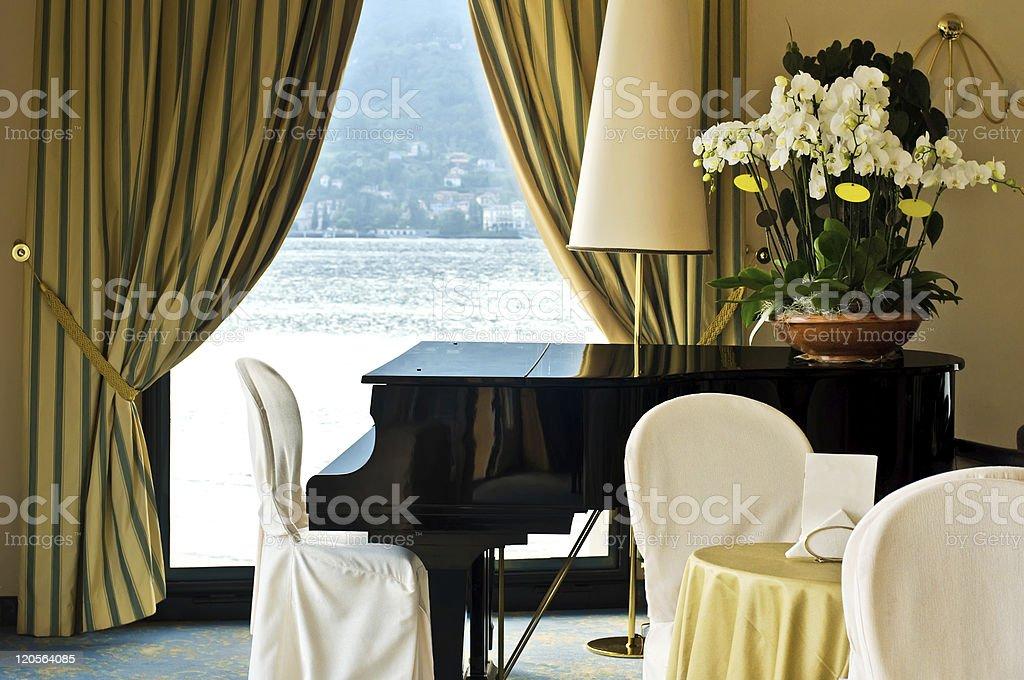 hotel interior with piano stock photo