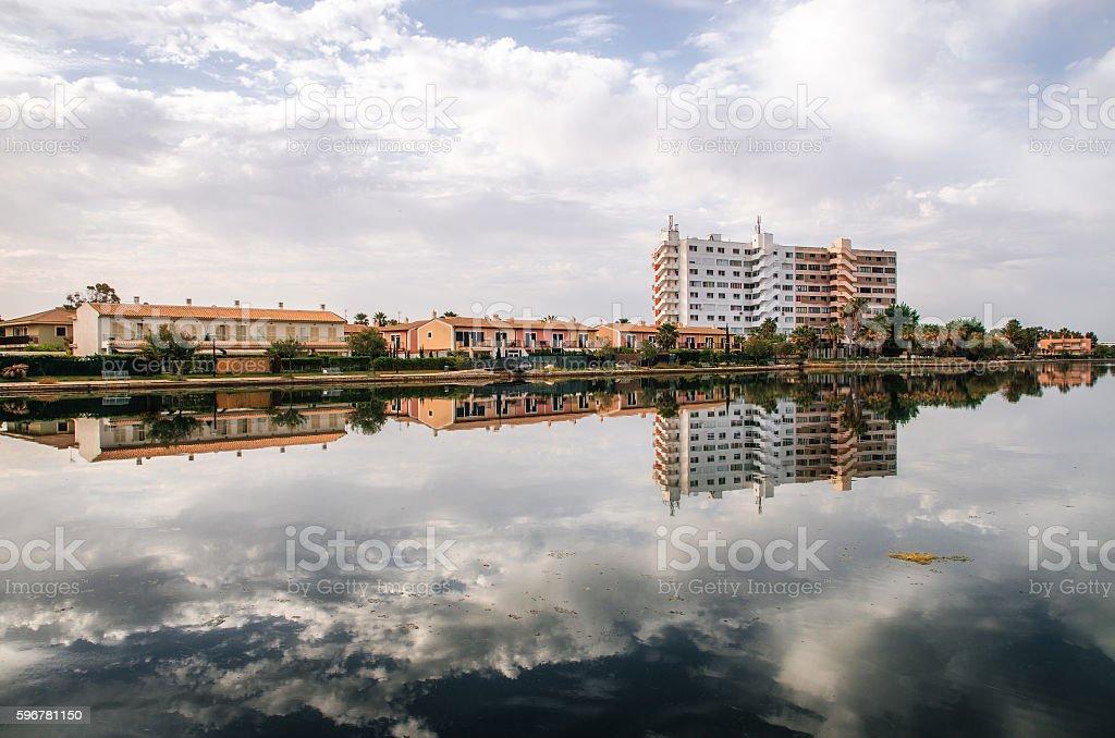 Hotel is reflected in the Esperanza lake in Puerto Alcudia стоковое фото