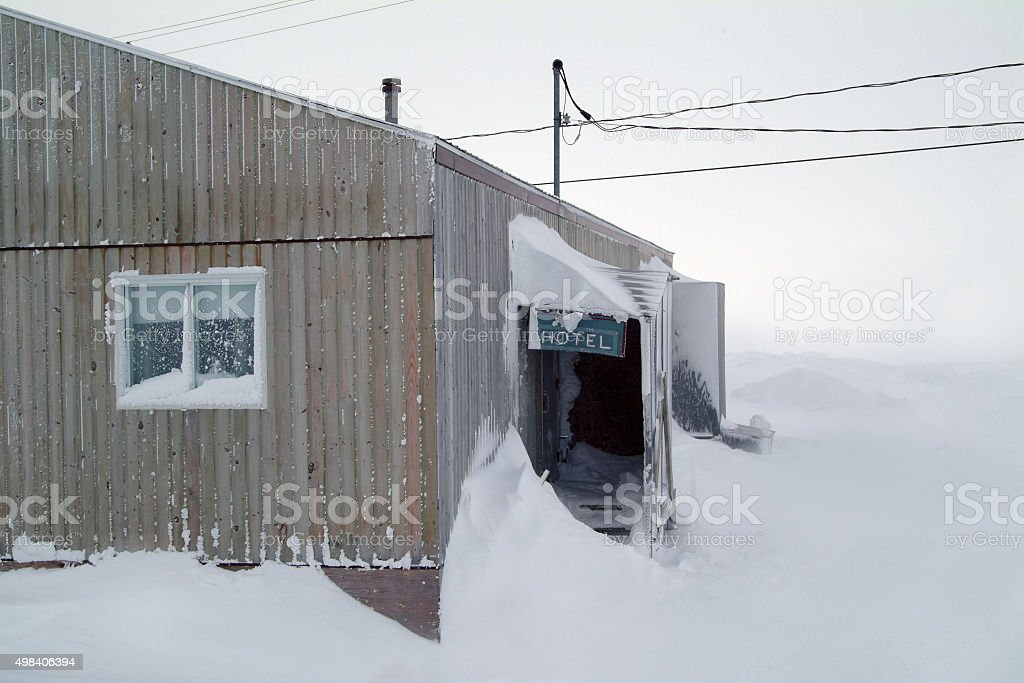 Hotel isolated in the blizzard. stock photo