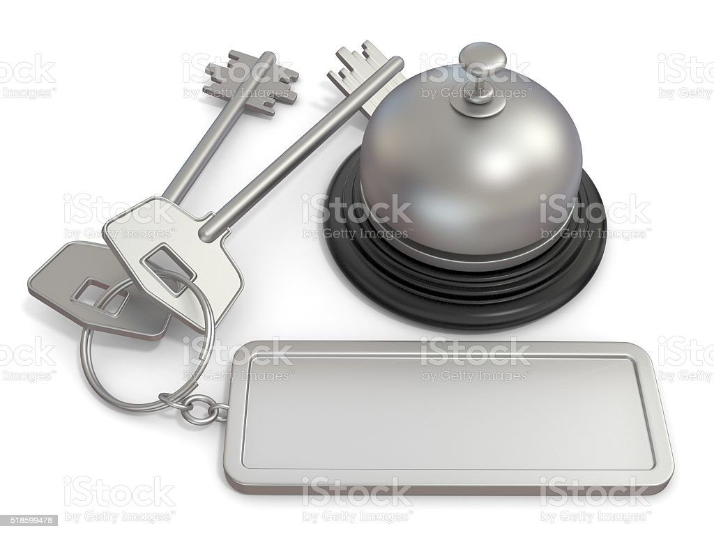 Hotel key with rectangular blank label and reception bell stock photo