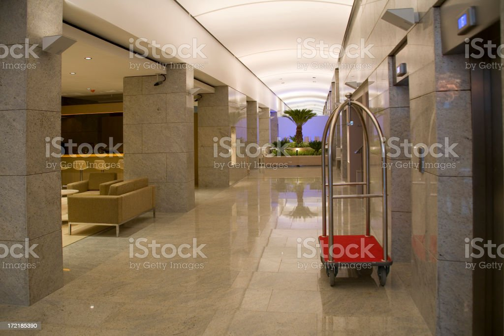 Hotel lobby with luggage cart next to elevator doors royalty-free stock photo