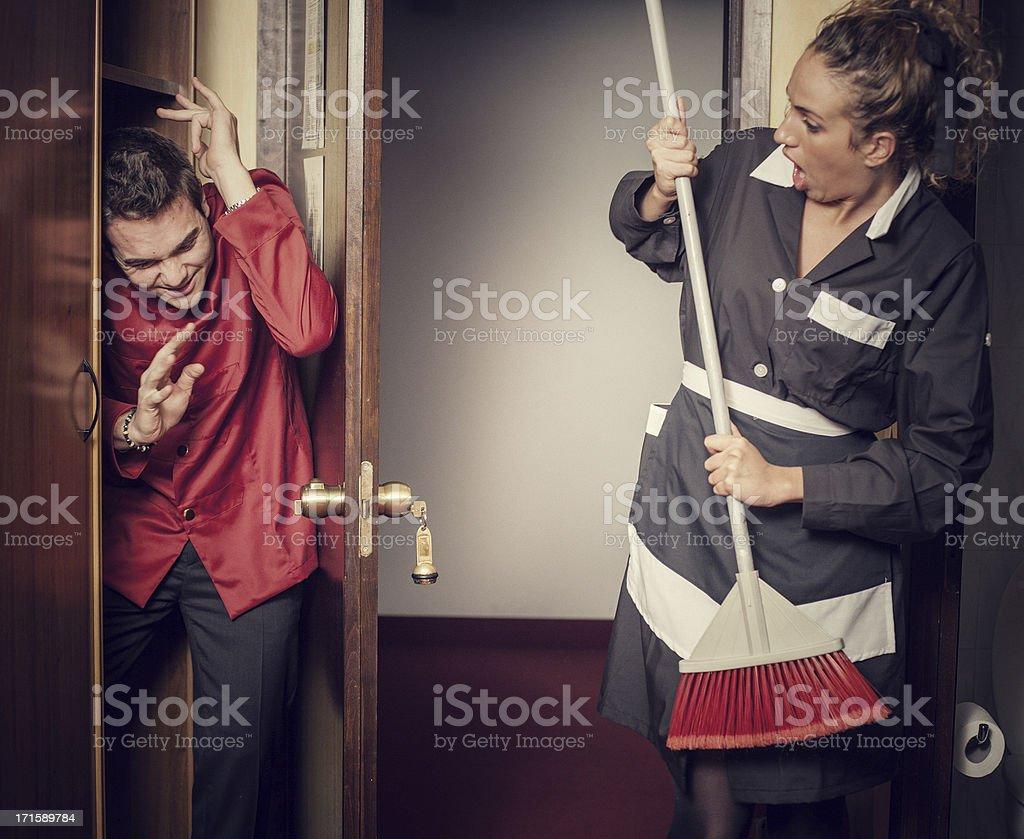Hotel maid beating hidden porter stock photo