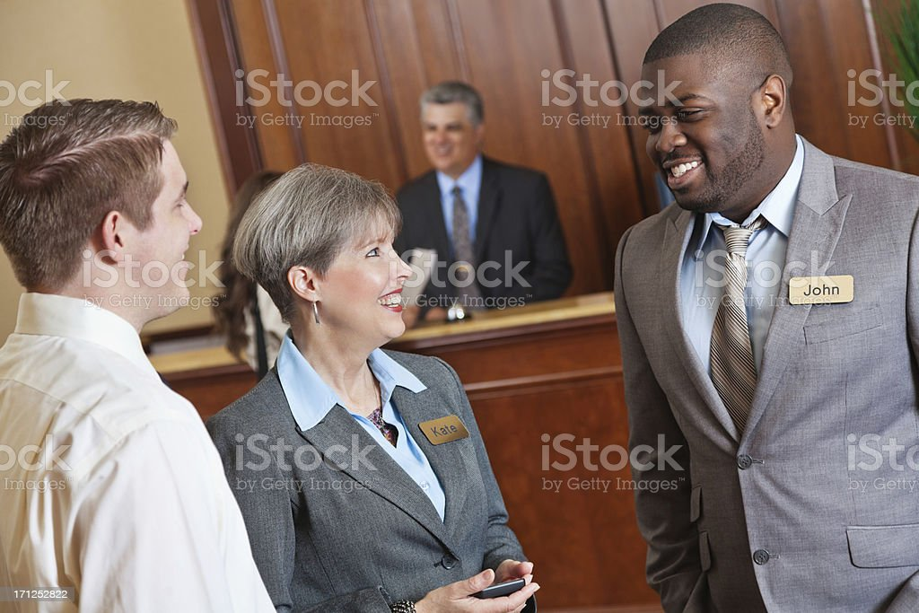Hotel management team talking in the lobby royalty-free stock photo