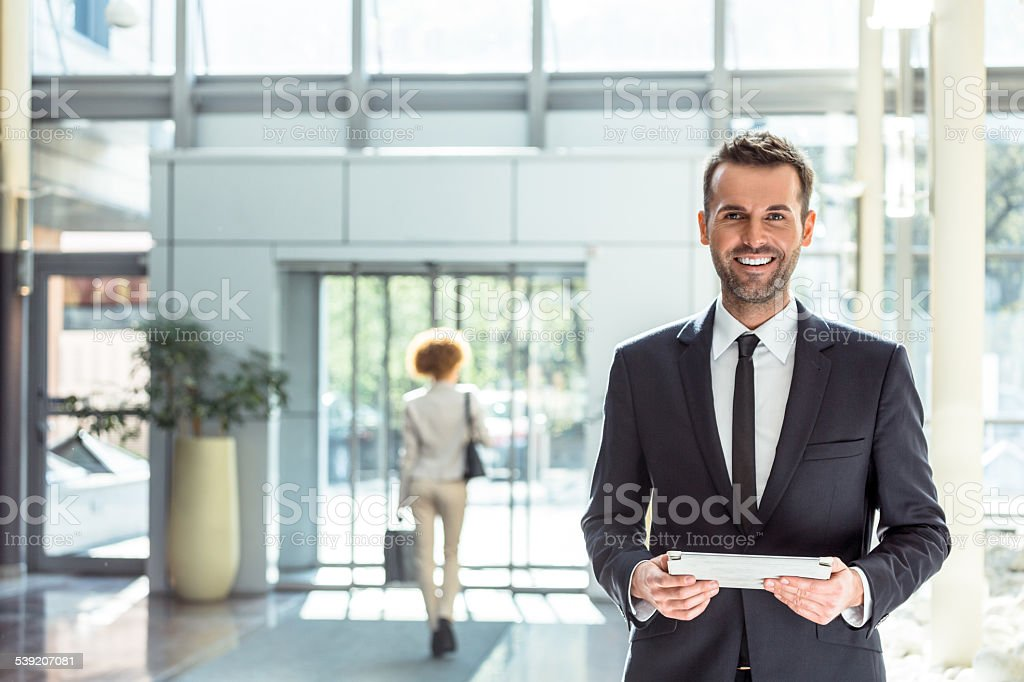 Hotel manager with a digital tablet stock photo