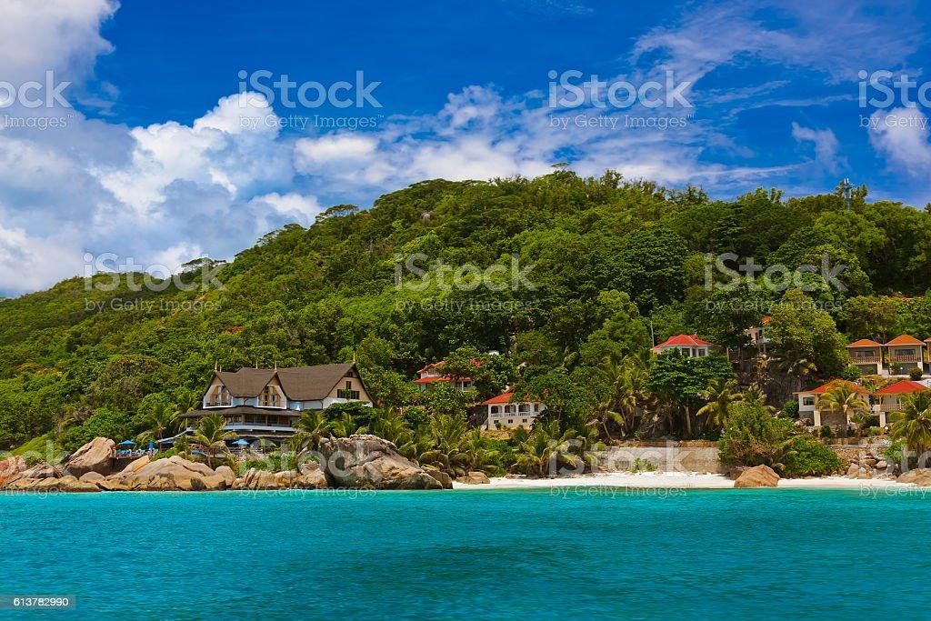 Hotel on tropical beach - La Digue Seychelles stock photo
