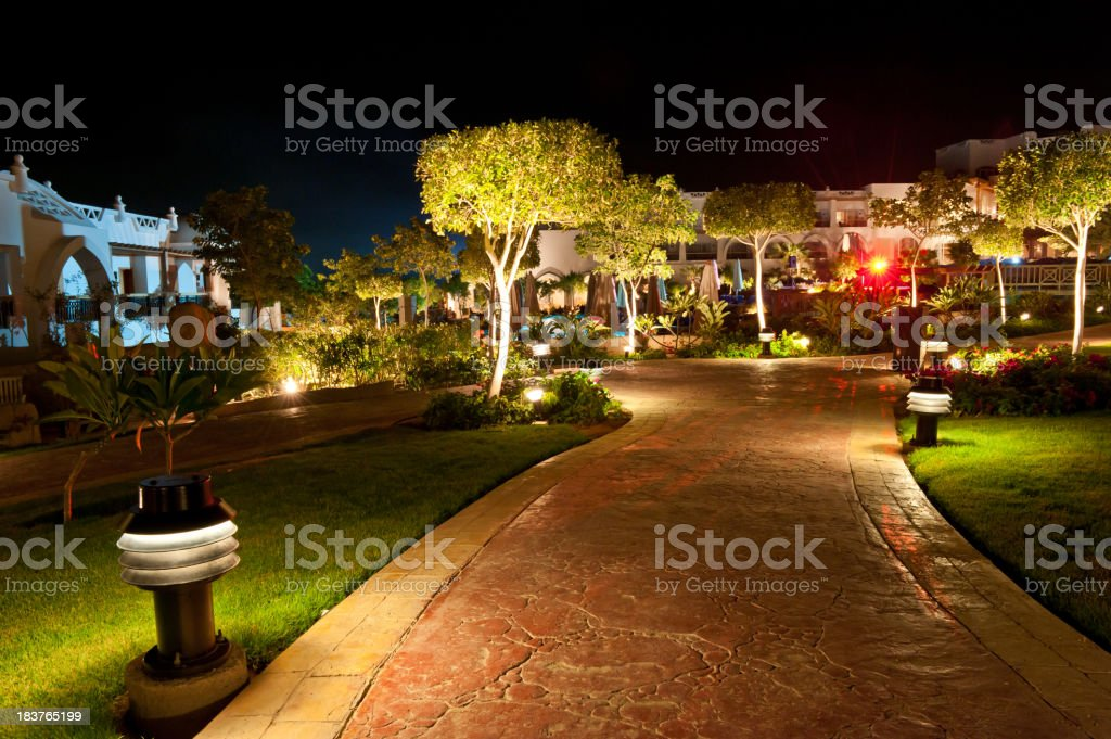 Hotel path illuminated by red light stock photo