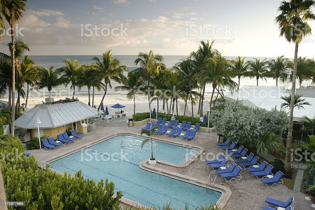 Hotel pool at sunset. royalty-free stock photo